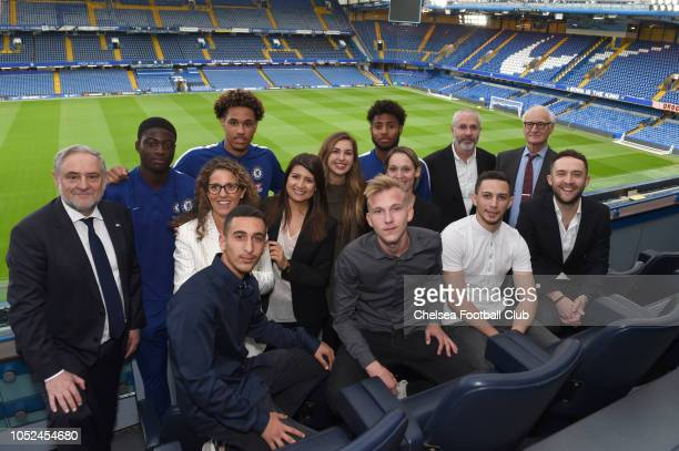 UK Director Eugene Tenenbaum Robert Singer Chairman Bruce Buck and Academy players Jon Russell Clinton Mola and Marcel Lavinier with the winners from...