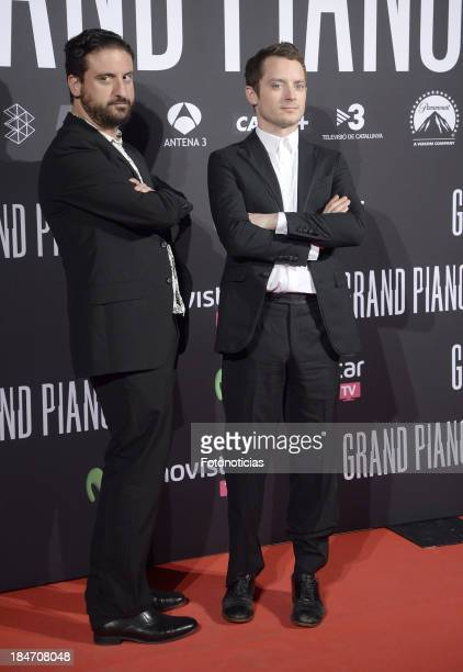 Director Eugenio Mira and actor Elijah Wood attend the premiere of 'Grand Piano' at Capitol cinema on October 15, 2013 in Madrid, Spain.