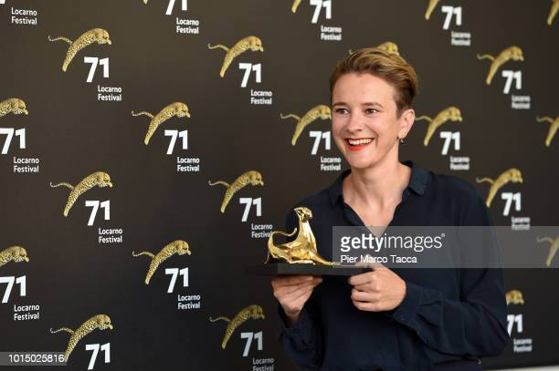 Director Eva Trobisch poses with Pardo prize for the Best First Feature at the Palmares photocall during the 71st Locarno Film Festival on August 11...