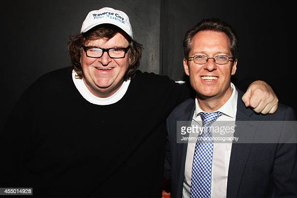 Director / Executive Producer Michael Moore and moderator Thom Powers pose for a portrait during the 25th Anniversary screening of Roger Me during...