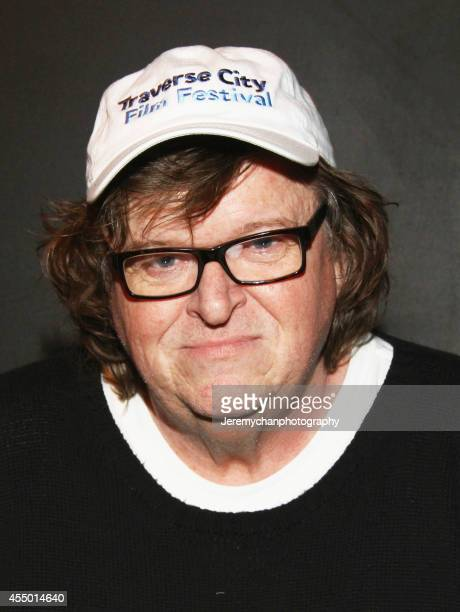Director / Executive Producer Michael Moore poses for a portrait during the 25th Anniversary screening of Roger Me during the 2014 Toronto...