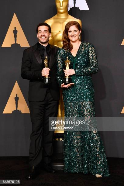 Director Ezra Edelman and producer Caroline Waterlow, winners of Best Documentary Feature for 'O.J.: Made in America' pose in the press room during...