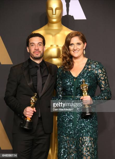 Director Ezra Edelman and producer Caroline Waterlow, winners of Best Documentary Feature for 'O.J.: Made in America' pose in the press room at the...