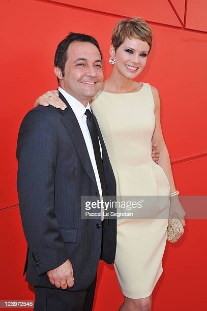 Director Fabrizio Cattani and actress Andrea Osvart attend the Maternity Blues premiere during the 68th Venice Film Festival at Palazzo del Cinema on...
