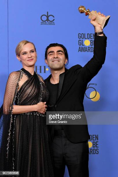 Director Fatih Akin winner of the award for Best Motion Picture for 'In the Fade' and actor Diane Kruger pose in the press room during The 75th...