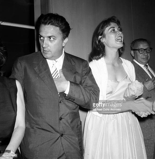 Director Federico Fellini and Gia Scala at his cocktail party in Los Angeles California