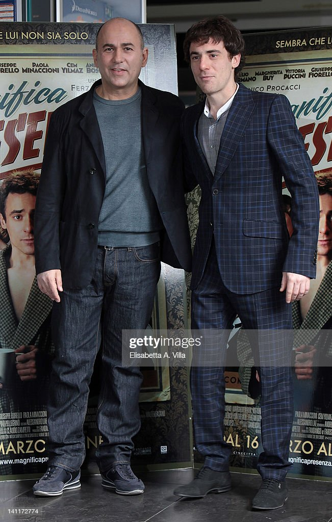 Director Ferzan Ozpetek (L) and actor Elio Germano attend 'Magnifica Presenza' photocall at Adriano Cinema on March 12, 2012 in Rome, Italy.