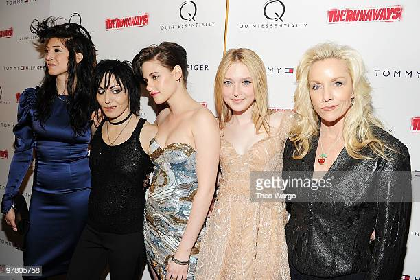 Director Floria Sigismondi musician Joan Jett actress Kristen Stewart actress Dakota Fanning and musician Cherie Currie attend The Runaways New York...