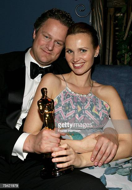 Director Florian Henckel von Donnersmarck poses with his award for Best Foreign Language Film and wife Christiane Asschenfeldt at the Governor's Ball...