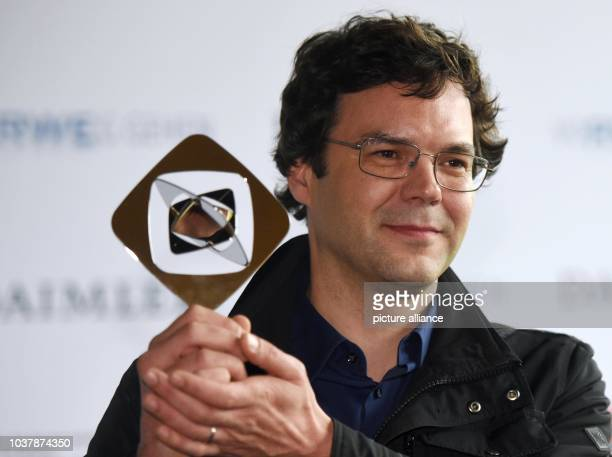 Director Florian Schwarz with his award in the Fiktion category for the film Tatort Im Schmerz geboren at the Grimme Awards in Marl Germany 27 March...
