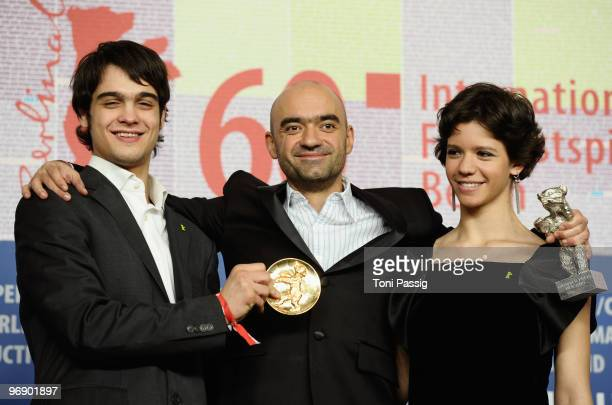 Director Florin Serban holds his Silver Bear Jury Grand Prix Award with actress Ada Condeescu and actor George Pistereanu at the 'Award Winners'...