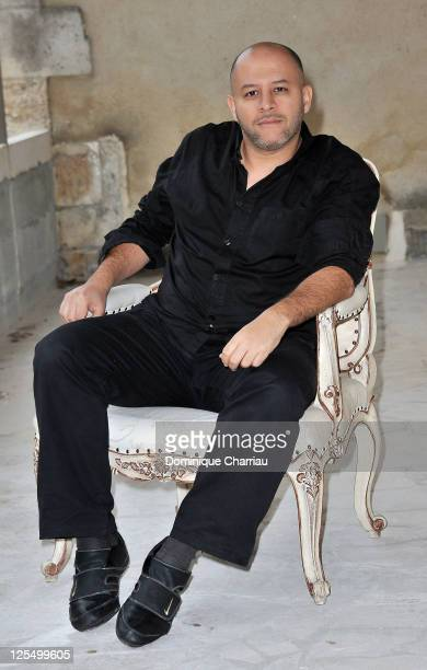 Director Fouad Benhammou poses for the photocall of 'Le village des ombres' at hotel Renoir during the Festival of sarlat on November 11 2010 in...