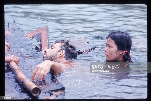 Director Francis Ford Coppola demonstrates a scene to an actress during the filming of 'Apocalypse Now' April 28 1976 in the Philippines The movie...
