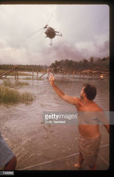Director Francis Ford Coppola directs a helicopter to the right location April 28 1976 during the filming of 'Apocalypse Now' in the Philippines The...
