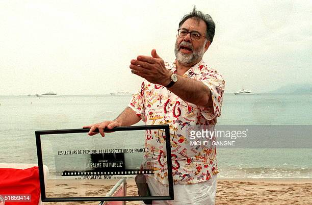 US director Francis Ford Coppola gestures 12 May after being awarded a 'Public Palm' prize for Apocalypse Now' The prize was given after consultation...