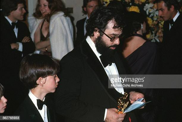 Director Francis Ford Coppola holds his Oscar after winning Best Director and Best Picture award during the 47th Academy Awards at Dorothy Chandler...