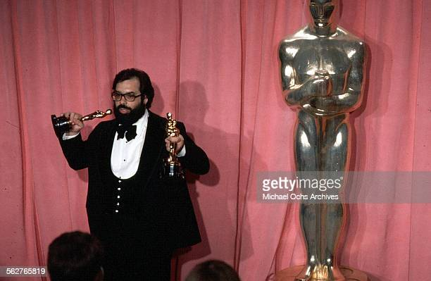 """Director Francis Ford Coppola pose backstage with his Oscar after winning """"Best Director"""" and """"Best Picture"""" award during the 47th Academy Awards at..."""