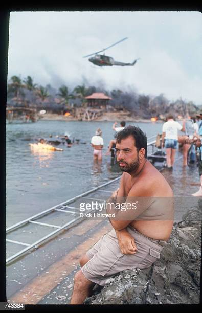 Director Francis Ford Coppola sits on a rock April 28 1976 during the filming of 'Apocalypse Now' in the Philippines The film is based on the novel...