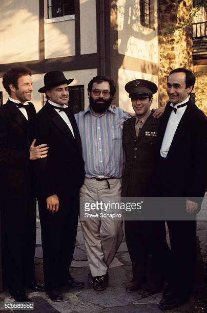 Director Francis Ford Coppola with actors James Caan Marlon Brando Al Pacino and John Cazale during filming of The Godfather