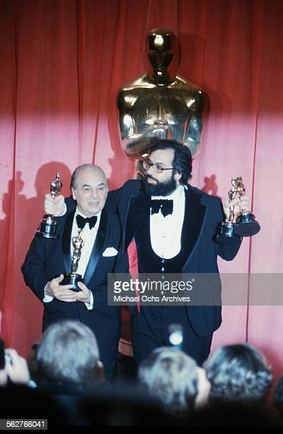 Director Francis Ford Coppola with his father Carmine pose backstage with his Oscar after winning Best Director and Best Picture award during the...