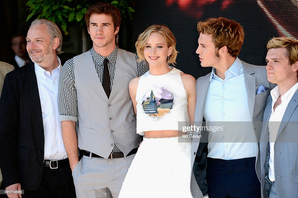 Director Francis Lawrence, actors Liam Hemsworth, Jennifer Lawrence, Sam Claflin and Josh Hutcherson attend 'The Hunger Games: Mockingjay Part 1' photocall at the 67th Annual Cannes Film Festival on May 17, 2014 in Cannes, France.