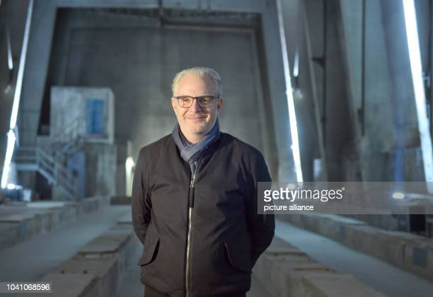 USdirector Francis Lawrence poses for a photo at 'Kraftwerk' one of the shooting locations of the film 'The Hunger Games Mockingjay Part 2' in...