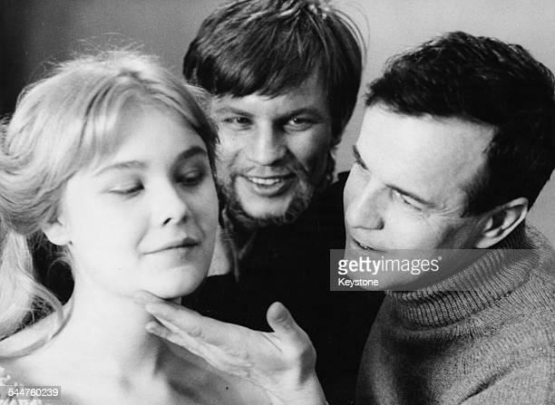 Director Franco Zeffirelli rehearsing with actors Natasha Pyne and Michael York for the film 'The Taming of the Shrew' 1967