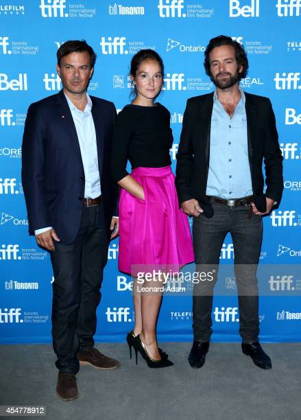 Director Francois Ozon actress Anais Demoustier and actor Romain Duris of 'The New Girlfriend' pose at 'The New Girlfriend' Press Conference during...