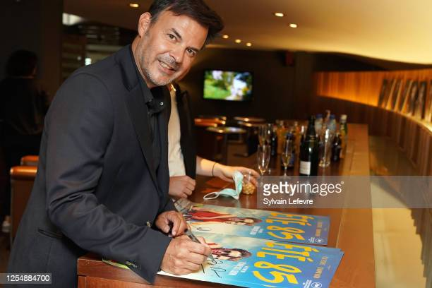 Director Francois Ozon signs the movie poster before the premiere of their film Ete 85 on July 07 2020 in Lille France