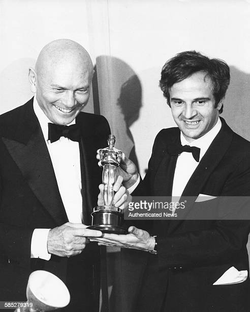 Director Francois Truffaut holding Best Foreign Language Film Oscar for 'Day for Night' with presenter Yul Brynner at the 46th Academy Awards Los...