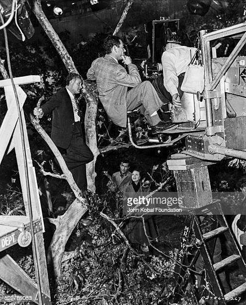 Director Frank Borzage and actor Ray Milland , standing on a camera crane during the filming of the movie 'Till We Meet Again', for Paramount...