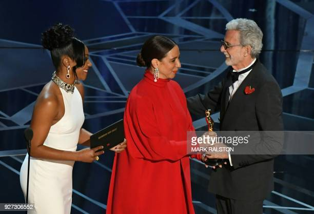 US director Frank Stiefel accepts the Oscar for Best Documentary Short Subject for 'Heaven is a traffic Jam on the 405' from US actress Maya Rudolph...