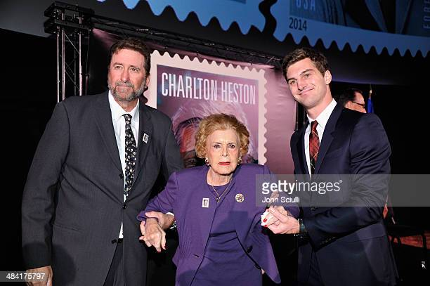 Director Fraser Heston, actress Lydia Clarke and Jack Heston attend the postage stamp ceremony during the 2014 TCM Classic Film Festival at TCL...
