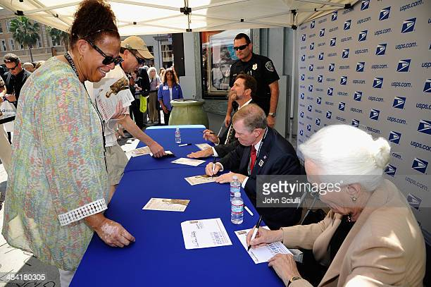 Director Fraser Heston, Governor of the United States Postal Service Mickey D. Barnett, and CEO and Director of AFI Jean Picker Firstenberg attend...