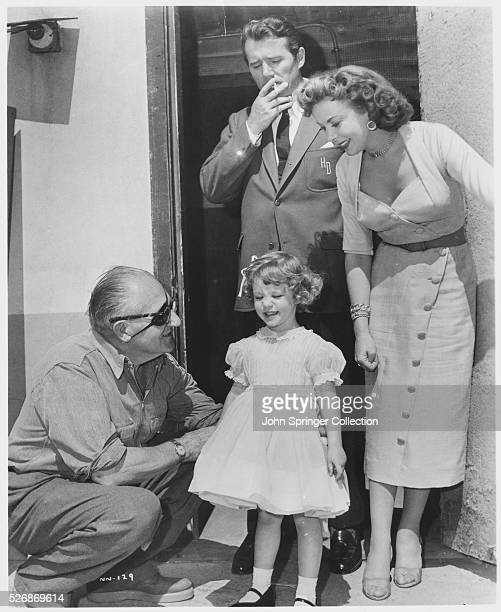 Director Fritz Lang with child actress Bridget Duff on the set of the 1956 movie While the City Sleeps Actor Howard Duff and actress Ida Lupino play...