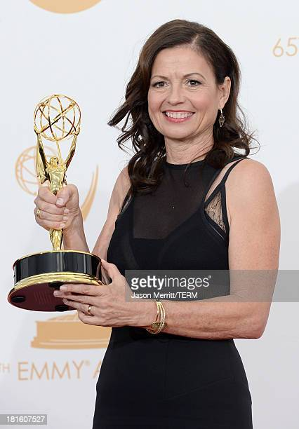 Director Gail Mancuso winner of Outstanding Directing for a Comedy Series award for Modern Family poses in the press room during the 65th Annual...