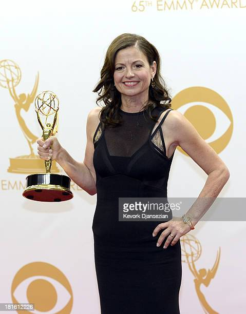 Director Gail Mancuso winner of the Best Directing for a Comedy Series for 'Modern Family' poses in the press room during the 65th Annual Primetime...