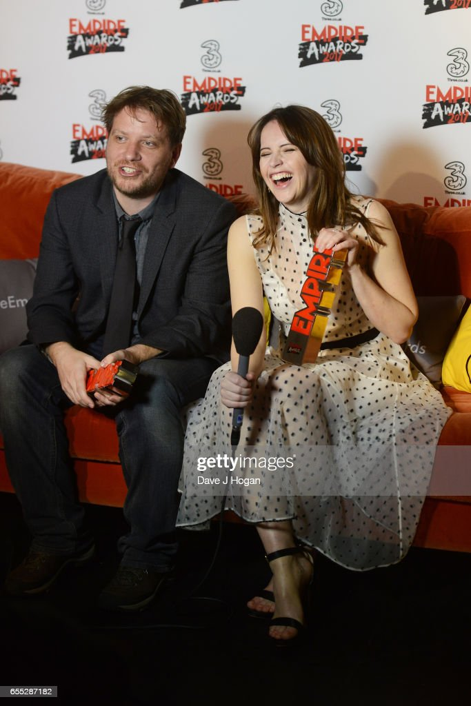 Director Gareth Edwards and Felicity Jones pose with the awards for Best Actress and Best Director for Rogue One: A Star Wars Story in the winners room at the THREE Empire awards at The Roundhouse on March 19, 2017 in London, England.