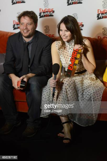 Director Gareth Edwards and Felicity Jones pose with the awards for Best Actress and Best Director for Rogue One A Star Wars Story in the winners...