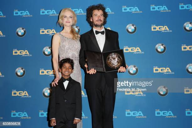 """Director Garth Davis recipient of the Feature Film Nomination Plaque for """"Lion"""" poses with actor Sunny Pawar and actress Nicole Kidman in the press..."""