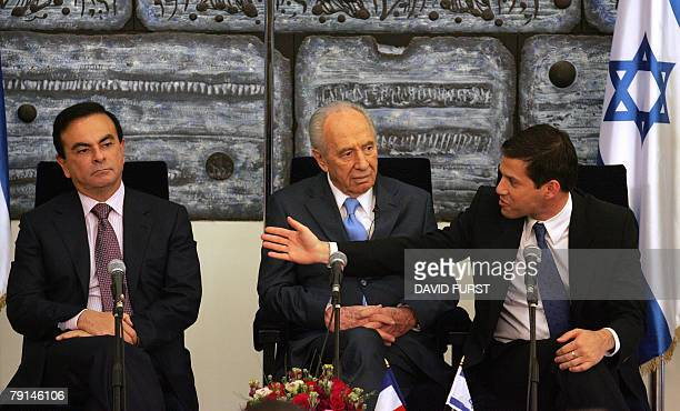Director General of Better Project Shai Agassi gestures past Israeli President Shimon Peres toward President of French automaker RenaultNissan Carlos...