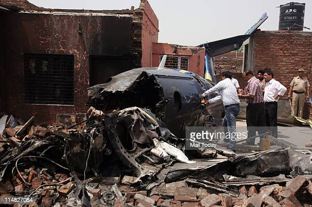Director General of Civil Aviation team inspect the crash site after the aircraft crashed into a residential area of Faridabad on Wednesday night.