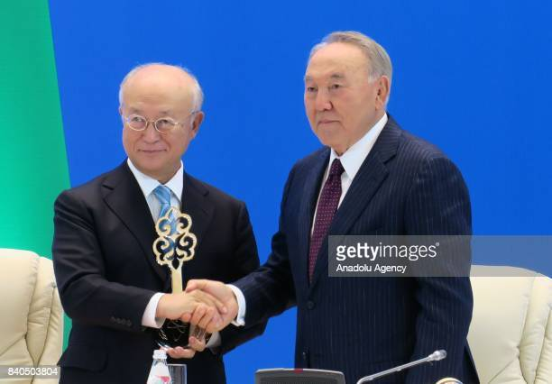 Director General of IAEA Yukiya Amano receives the symbolical key to the facility from President of Kazakhstan Nursultan Nazarbayev during the...