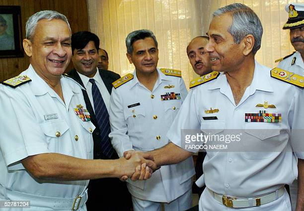 Director general of the Indian Coast Guard Vice Admiral Arun Kumar Singh shakes hands with Pakistani Admiral AhsanulHaq additional secretary Ministry...