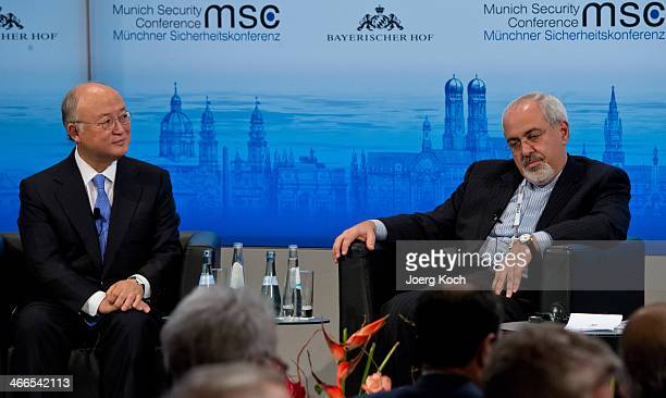 Director General of the International Atomic Energy Agency Yukiya Amano and Iranian Foreign Minister Mohammed Javad Zarif meet during the 50th Munich...