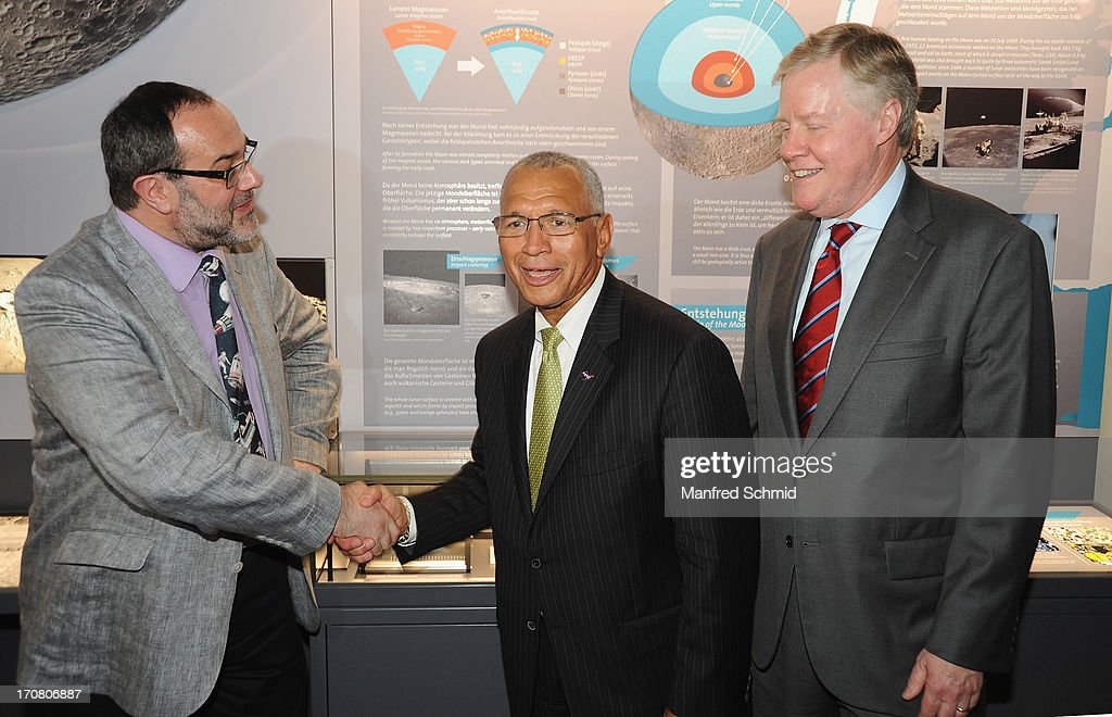 Director general of the Naturhistorisches Museum Christian Koeberl and Administrator of NASA Charles Bolden shake hands as U.S. Ambassador to Austria William C. Eacho looks on during the handover of moon rocks from NASA Apollo Missons 15 and 17 at the Natural History Museum on June 18, 2013 in Vienna, Austria. The National Aeronautics and Space Administration (NASA) is loaning three samples of moon rocks long term to the Naturhistorisches Museum.