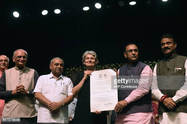Director General of UNESCO Irina Bokova hands over the certificate of 'Historic City of Ahmedabad' to Gujarat state Chief Minister Vijaybhai Rupani...