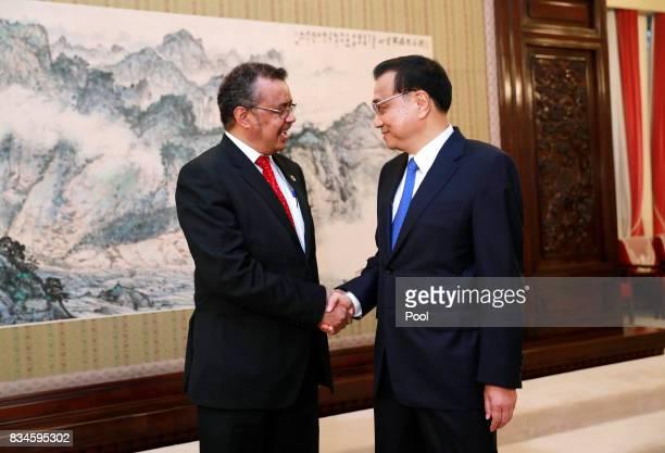 Director general of World Health Organisation Tedros Adhanom Ghebreyesus and Chinese Premier Li Keqiang shake hands during their meeting at...