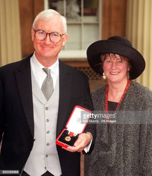BBC director general Sir John Birt at Buckingham Palace with his wife Jane after he received a knighthood from the Queen