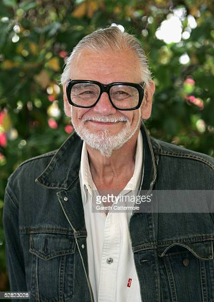 Director George A Romero attends a photocall promoting the film ' Land of the Dead ' at the Martinez Poolside during the 58th International Cannes...